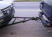 Буксировка авто на жесткой сцепке фото